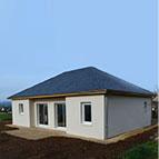 maison ossature bois moderne avec toiture en ardoise